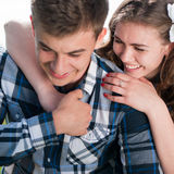 Happy Young couple hugging & smiling Royalty Free Stock Photos