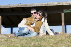 Happy young couple hugging and smiling outdoor Royalty Free Stock Image