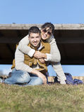 Happy young couple hugging and smiling outdoor Stock Image