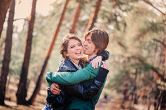 Happy young couple hugs on the walk in forest Royalty Free Stock Image