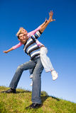Happy young couple  jumping Royalty Free Stock Photo