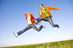 Happy young couple  jumping Stock Images