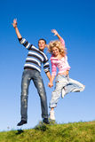 Happy young couple  jumping in sky Stock Photography