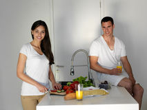 Happy young couple in kicthen Stock Photography