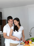 Happy young couple in kicthen Royalty Free Stock Photography