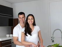 Happy young couple in kicthen Stock Photos