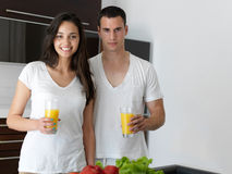 Happy young couple in kicthen Stock Photo