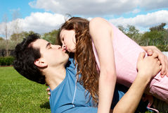 Happy young couple kissing Royalty Free Stock Photography