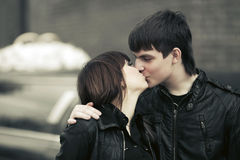 Happy young couple kissing in a city street Stock Photo