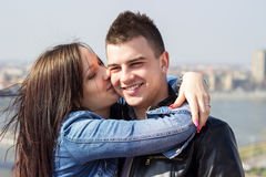 Happy young couple kissing and embracing Stock Photos