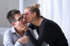 Happy young couple kissing in the office Royalty Free Stock Photos