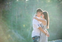 Happy young couple kissing outdoors Royalty Free Stock Images