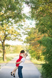 Happy young couple kissing in park Royalty Free Stock Photo