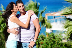 Happy young couple kissing  on a sea background Stock Photo
