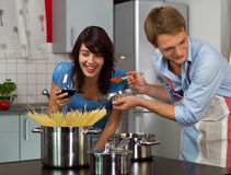 Happy young couple in the kitchen Stock Photos