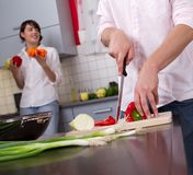 Happy young couple in the kitchen Stock Photography