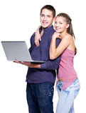 Happy young couple with laptop. On white background Royalty Free Stock Photography