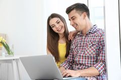 Happy young couple with laptop. At home Royalty Free Stock Photo