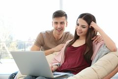 Happy young couple with laptop. At home Royalty Free Stock Images
