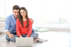 Happy young couple with laptop. At home Royalty Free Stock Photography