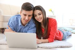Happy young couple with laptop. At home Stock Image