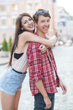 Happy young couple laughing in the city. Love Story series. Stock Images