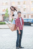 Happy young couple laughing in the city. Love Story series. Royalty Free Stock Images