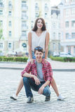 Happy young couple laughing in the city. Love Story series. Royalty Free Stock Image