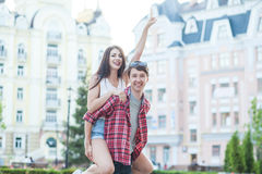 Happy young couple laughing in the city. Love Story series. Stock Image