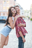 Happy young couple laughing in the city. Love Story series. Stock Photos