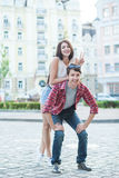 Happy young couple laughing in the city. Love Story series. Royalty Free Stock Photos