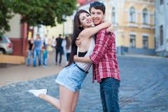 Happy young couple laughing in the city. Love Story series. Stock Photography