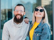 Happy young couple leisure casual urban lifestyle. Happy young couple. Leisure time. Casual urban lifestyle. Smiling young man and woman royalty free stock images