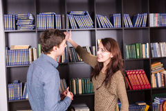 Happy Young Couple at Library Looking Each Other Royalty Free Stock Photography