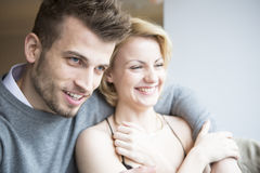 Happy young couple looking away in cafe Stock Images
