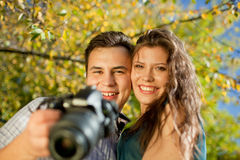Happy young couple looking at camera Stock Photography