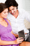 Happy young couple looking at cds Stock Images