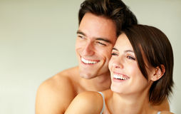 Happy young couple looking at copyspace Stock Images