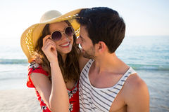 Happy young couple looking at each other at beach Royalty Free Stock Photos