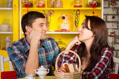 Happy Young Couple Looking Each Other at the Cafe Royalty Free Stock Image