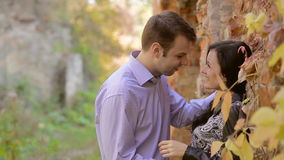 Happy young couple looking at each other and smiling outdoor. Portrait of happy young couple looking at each other and smiling outdoor stock footage