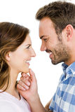 Happy young couple looking at each other and smiling Royalty Free Stock Photography
