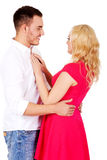 Happy young couple looking into eachother eyes Stock Photos