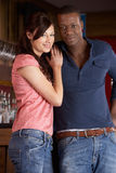 Happy young couple in love. Smiling at camera Royalty Free Stock Images