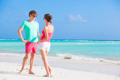 Happy young couple in love on the beach Stock Images