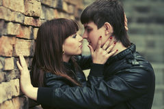 Happy young couple in love at the brick wall Royalty Free Stock Image