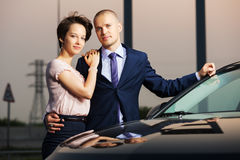 Happy young couple in love at the car. Outdoor Stock Photos