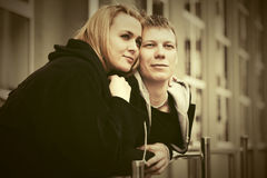 Happy young couple in love on city street Royalty Free Stock Images