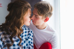 Happy young couple in love close to each other tenderly kissing Royalty Free Stock Images