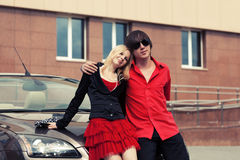Happy young couple in love by convertible car Stock Images